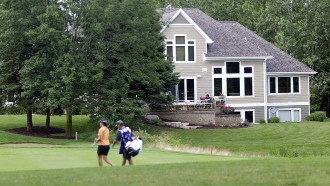 Mark and Beva Gathje's Hobart residence offers a view of Thornberry Creek at Oneida golf course's 18th hole. Family and friends will gather on the Gathjes' deck to watch the inaugural LPGA Thornberry Creek Classic, which continues through Sunday.