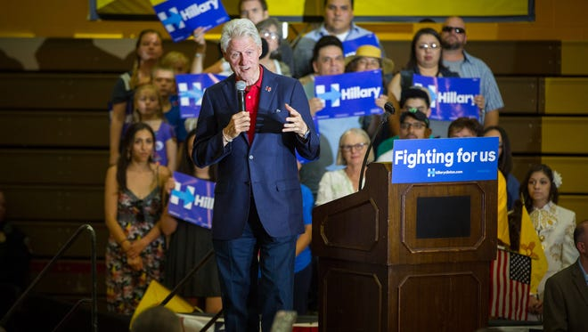 Former U.S. President Bill Clinton stumps for his wife, Hillary Clinton, during a rally on Monday at Picacho Middle School in Las Cruces.