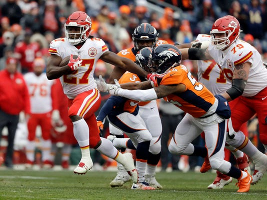 Kansas City Chiefs running back Kareem Hunt (27) runs for a touchdown past Denver Broncos inside linebacker Brandon Marshall during the first half of an NFL football game Sunday, Dec. 31, 2017, in Denver. (AP Photo/Jack Dempsey)