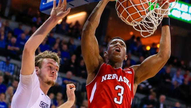 Nebraska guard Andrew White III (3) dunks against Creighton forward Toby Hegner (32) during the first half of an NCAA college basketball game in Omaha, Neb., Wednesday, Dec. 9, 2015.