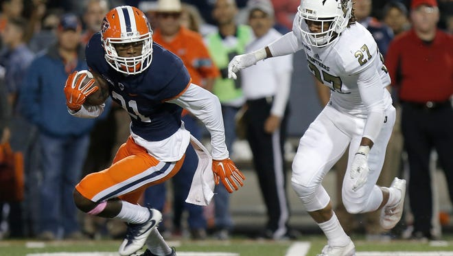 UTEP wide receiver Eddie Sinegal changes directions to avoid FIU cornerback Xavier Hines Saturday at the Sun Bowl.