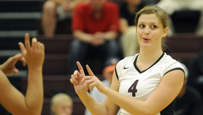 Stuarts Draft's Danielle Wilson celebrates a point with her team during the second game against Wilson Memorial on Tuesday, September 13, 2011.