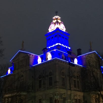 The Licking County Courthouse was lit blue to honor