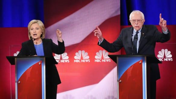 Hillary Clinton and Bernie Sanders debate in Charleston,