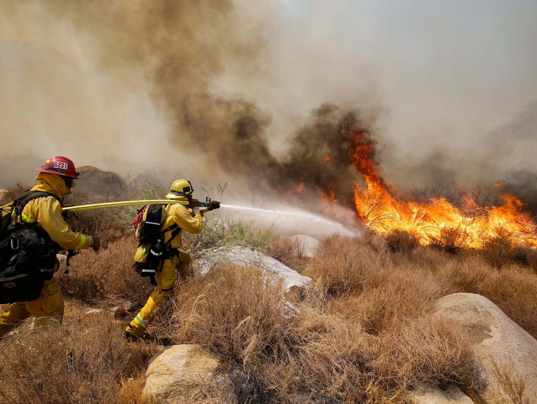 Firefighters hose down a blaze in Cabazon.