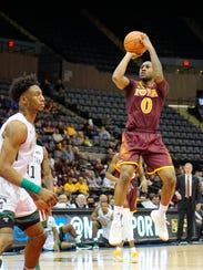 Rickey McGill rises to attempt a shot during Iona's