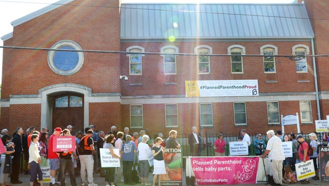 Hundreds turned out earlier this year for the National Day of Protest against Planned Parenthood, in front of the Planned Parenthood clinic in Mt. Auburn. A proposal before lawmakers would cut more than $1 million each year from the organization.