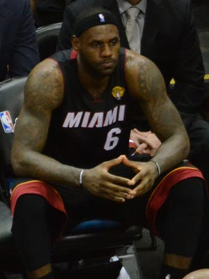 Heat forward LeBron James was on the bench at the end of Game 5, the finale of the NBA Finals.