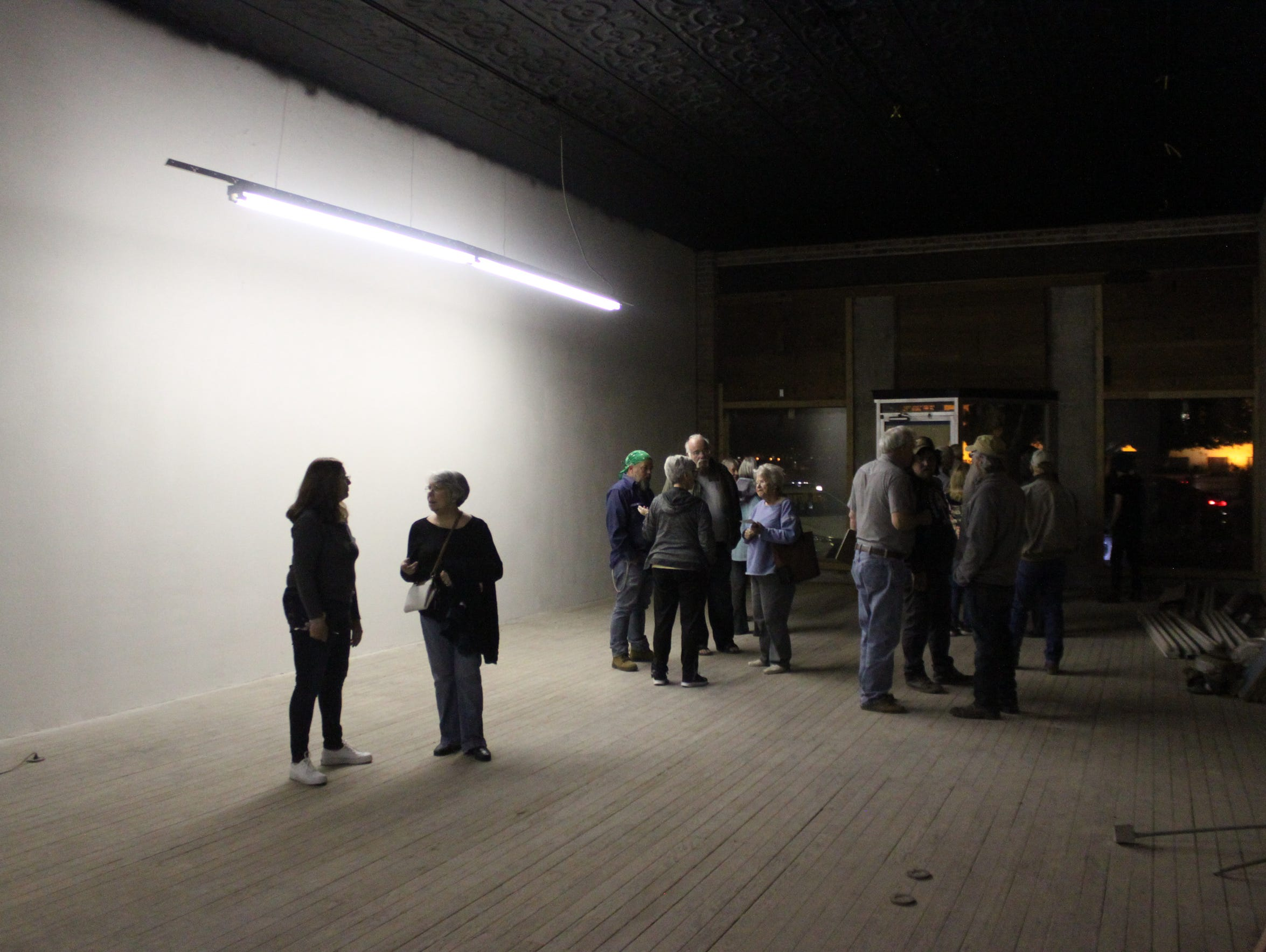 Members of the public survey the old rooms and artifacts
