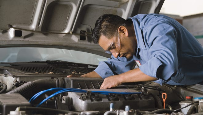 What questions should you ask if you buy an auto service contract?