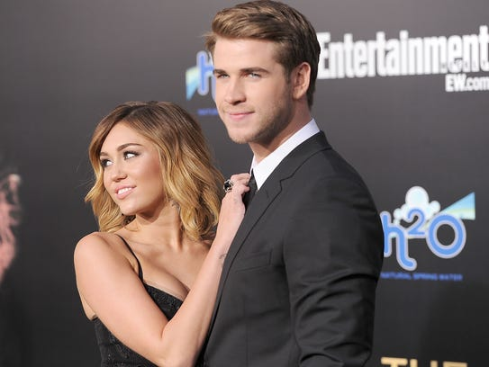 Miley Cyrus and Liam Hemsworth at a film premiere in