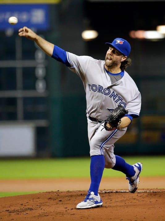 Toronto Blue Jays starting pitcher R.A. Dickey throws against the Houston Astros during the first inning of a baseball game Friday, May 15, 2015, in Houston. (AP Photo/David J. Phillip)