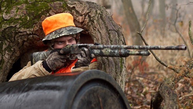 Wearing a blaze-orange-colored vest, hat, or pack cover is one of the most important things you can do to stay visible to hunters. It's what hunters themselves wear for safety.
