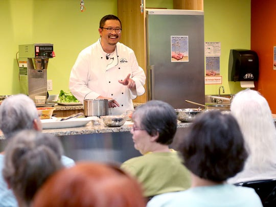 Statesman Journal columnist Victor Panichkul leads a Taste of Oregon cooking demonstration on gluten-free Asian basics at Natural Grocers in Salem on Friday, May 8, 2015.
