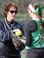 Kerri Gottfried hands the ball to her daughter, Darian, in 2015.