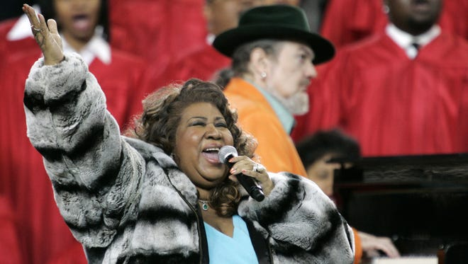 Aretha Franklin and Dr. John, rear, perform the national anthem before the Super Bowl XL football game Sunday, Feb. 5, 2006, in Detroit. (AP Photo/Gene J. Puskar)