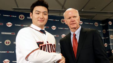 Byung Ho Park, left, of South Korea poses with Minnesota Twins general manager Terry Ryan after Park met the media Dec. 2, 2015, in Minneapolis.
