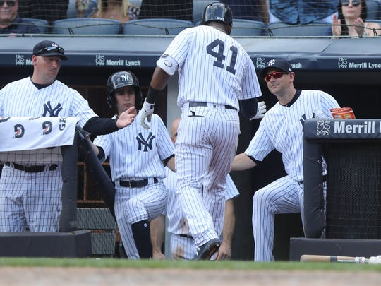 Miguel Andujar is greeted by manager Aaron Boone after hitting a solo home run in the 5th inning.