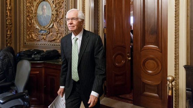 Sen. Thad Cochran, R-Miss., the ranking member of the Senate Agriculture Committee, leaves a closed-door GOP caucus luncheon at the Capitol in Washington, Tuesday, Jan. 14, 2014. The Senate is working on stalled unemployment legislation as Republicans and Democrats seek a compromise to restore benefits to 1.3 million long-term jobless workers who lost them abruptly late last year.  (AP Photo/J. Scott Applewhite) ORG XMIT: DCSA132