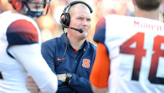 Former Syracuse Orange head coach Scott Shafer (center) begins planning for next year on Tuesday in his new role as MTSU's defensive coordinator.