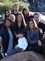 Former Guam Major League baseball player Eddie Aguon (center) is pictured here with his family. Bottom row (left to right): Lucas Lilio, Leslie Lilio, Diana Aguon, Leonidas Lilio, and Jolene Ignacio. Middle row (left to right): Eddie Aguon, Jaylene Ignacio and Bobby Ignacio. Top row (left to right): Quincee Lilio, Josten Ignacio and Jade Ignacio.