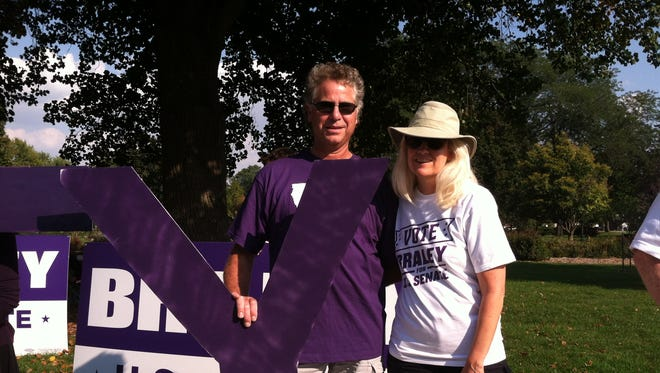 Tim Sadler, 57, of Pella and Ann Montgomery, 53, of Indianola stood outside of the Senate debate and rallied for Congressman Bruce Braley.