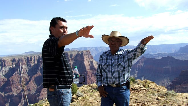 Bodaway/Gap Chapter President Perry Slim shows rancher Allan Nockideneh  where the resort will be located if the project is approved.