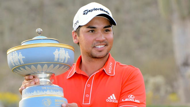 Jason Day poses with the Walter Hagen Trophy after winning the final round of the World Golf Championships - Accenture Match Play Championship.