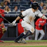 New York Yankees' Brett Gardner follows through on a single during the seventh inning of a baseball game against the Los Angeles Angels on Wednesday, June 8, 2016, in New York.