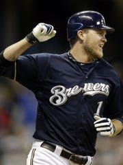 Milwaukee Brewers' Corey Hart reacts after getting the game-winning hit during the 13th inning of a baseball game against the Chicago Cubs Saturday, May 12, 2012, in Milwaukee. The Brewers won 8-7.