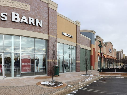 A number of new businesses are moving into the Green Oak Village Place Mall, including a Petco near these stores.