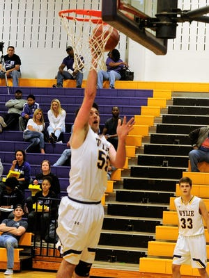 Wylie's Kyle Roberts lays in a basket during Tuesday's home game against Midland High. The Bulldogs won 88-51.