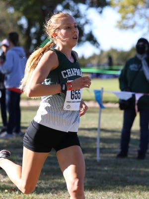 Chapman's Taylor Briggs raced her way into Kansas history on Saturday at the Class 4A state cross country meet at Wamego Country Club. Briggs became just the sixth girl in state history to win four straight state titles, winning by two minutes in 18:18.96.
