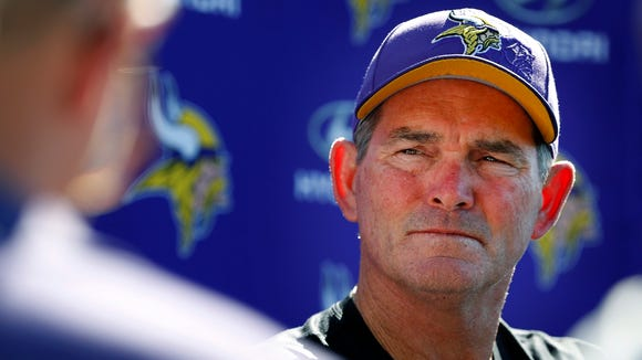 """Minnesota Vikings coach Mike Zimmer speaks to reporters after the injury of quarterback Teddy Bridgewater at practice on Tuesday, Aug. 30, 2016, in Eden Prairie, Minn. Vikings quarterback Teddy Bridgewater suffered a """"significant"""" knee injury in practice Tuesday and the team was awaiting tests to determine how long he might be out."""