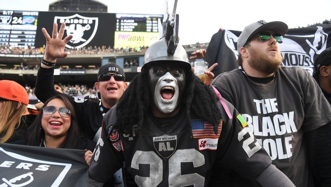 Oakland Raiders fan Ray Perez aka Dr. Death reacts during a NFL football game against the Buffalo Bills at Oakland-Alameda County Coliseum.