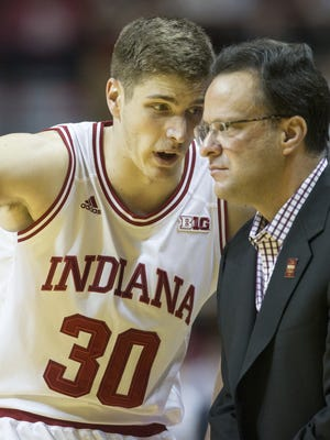 Collin Hartman of IU talked  strategy with Coach Tom Crean during a game earlier this year.