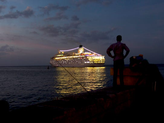 A man watches the British-owned Thomson Dream cruise