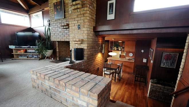 The living room, half a level higher than the rest of the house, is open to the dining room and entrance areas.
