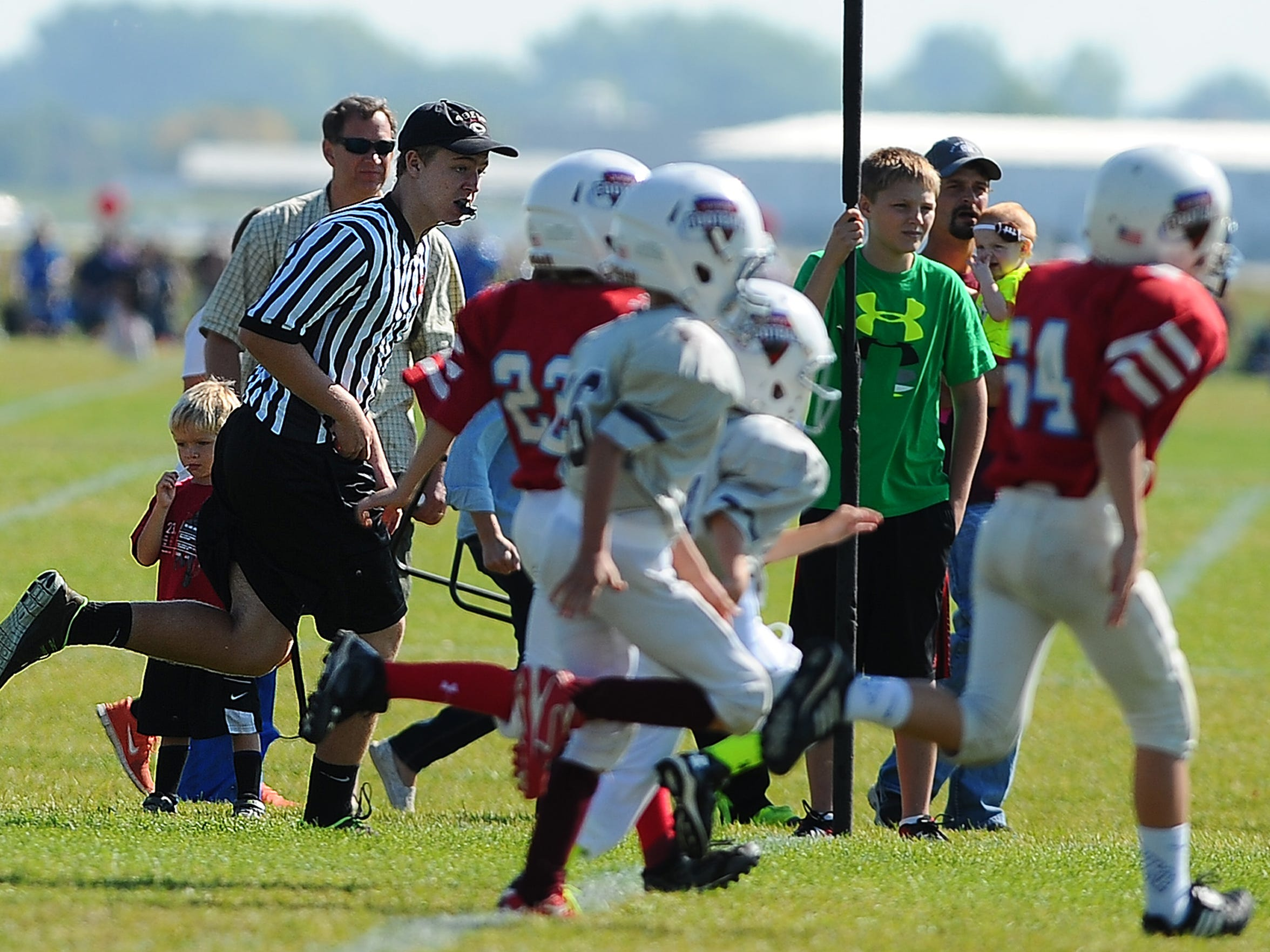 d1b1741d4 Xavier Kolb officiates a South Dakota Junior Football game at the Sanford  Sports Complex on Sept. 20. (Photo  Jay Pickthorn - Argus Leader Jay  Pickthorn ...