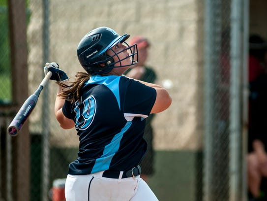 Richmond's Erin Shuboy looks up at her hit during a
