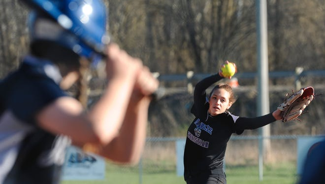 Granville Christian Academy's Chloe Brenneman delivers to the plate against Wellington last season.