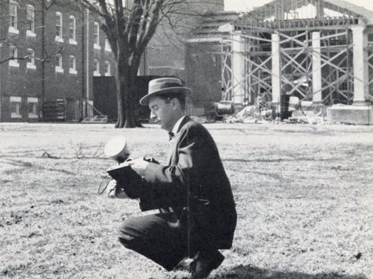 Ross Young is seen on the grounds of Wesley College in the 1950s as he prepares to capture an image for the school's yearbook.