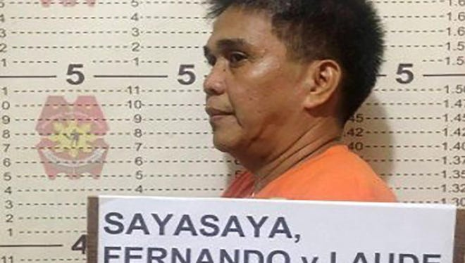 This undated handout photo released by the Philippine National Police (PNP) on November 22, 2017 shows the mugshot of Fernando Sayasaya, 53, in Calamba, Laguna, south of Manila. The ex-Filipino priest wanted in the United States for allegedly sexually abusing minors there faces extradition after his arrest in the Philippines where he has been hiding for 15 years, authorities said on November 22, 2017. Sayasaya is accused of molesting two brothers in the state of North Dakota when he was a Catholic priest there in the 1990s but he had fled to the Philippines before a US court issued an arrest warrant in 2002, local police said.
