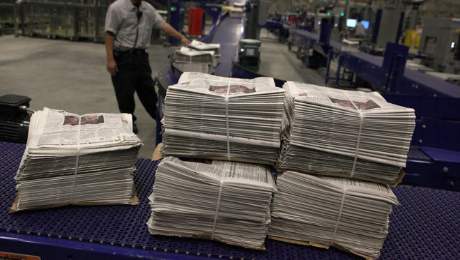 Stacks of newspapers waiting to be read.