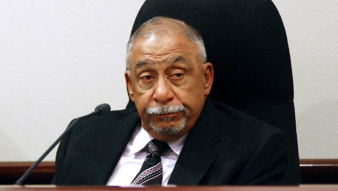 In this Nov. 14, 2017, file photo, former New Mexico state Sen. Phil Griego testifies at his own trial on corruption charges in Santa Fe, N.M. Democrat Griego will soon learn whether he will spend time behind bars for fraud, bribery and other convictions. A sentencing hearing for Griego is scheduled Friday, Feb. 16, 2018, in Santa Fe.