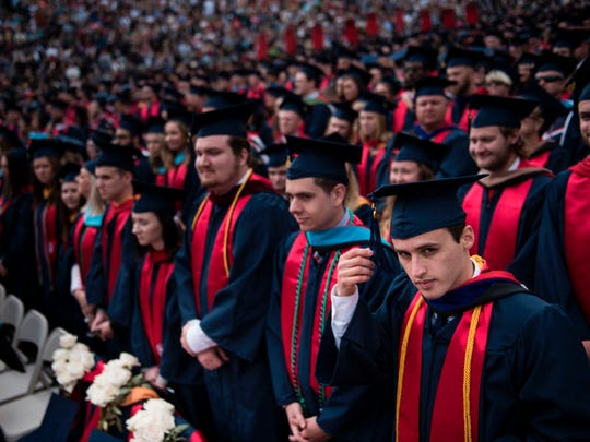 Students wait to hear President Trump speak during Liberty University's commencement ceremony.