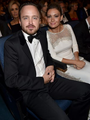 Aaron Paul and Lauren Parsekian pose at the 66th Primetime Emmy Awards at the Nokia Theatre L.A. Live on Monday, Aug. 25, 2014, in Los Angeles.