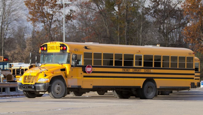 School buses are parked in the Pinckney Community Schools transportation garage Friday, Nov. 10, 2017. Several elementary school students were spoken to by police for making prank calls from a school bus about houses on fire.