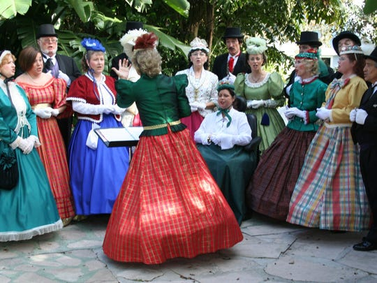 The Dickens Carolers will perform this Saturday at