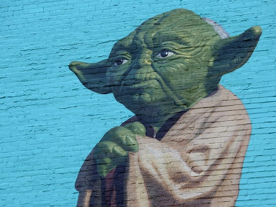 Star Wars character, Yoda, is part of ArtWorks' newest mural called 'Toy Heritage'. The mural focuses on the legacy of Kenner Toys, a Cincinnati-based toy company founded in 1947.